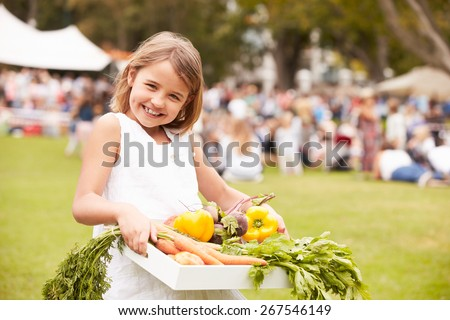 Girl With Fresh Produce Bought At Outdoor Farmers Market - stock photo