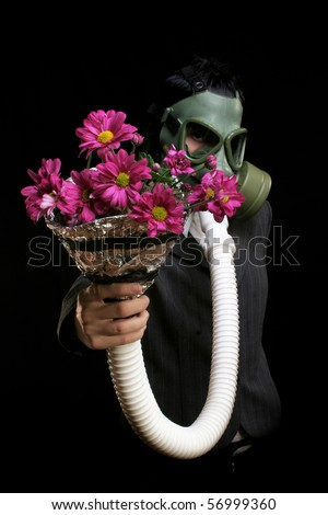 Girl with gas mask and flowers rehabilitating from work and pollution - stock photo