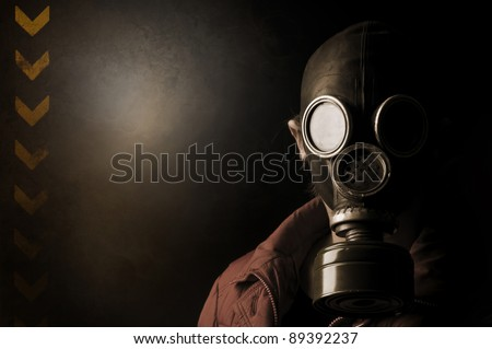Girl with gas mask in a grunge background - stock photo