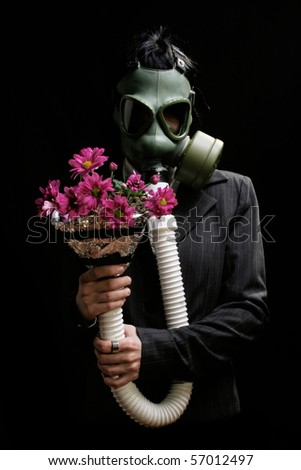 girl with gas mask rehabilitating from stress and pollution - stock photo