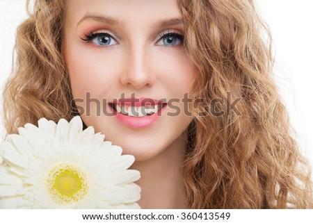 Girl with gerbera flower in studio - stock photo