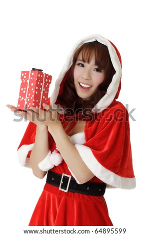 Girl with gift in Christmas, closeup portrait of happy Asian woman in Santa Claus clothes. - stock photo