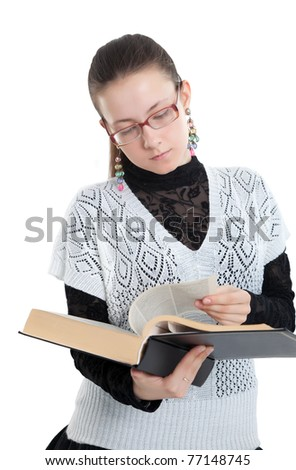 Girl with glasses reading a book.  Isolated on white background