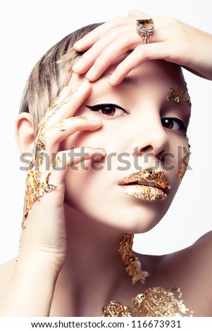 Girl with gold foil - stock photo
