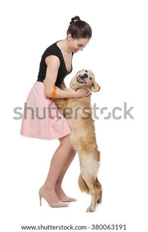 Girl with golden retriever dog - stock photo