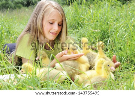 girl with gosling - stock photo