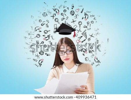 Girl with graduation hat on light blue background with sketches - stock photo