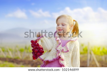 girl with grape on the vineyard