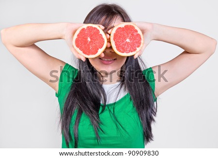 girl with grapefruit