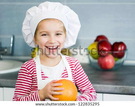 girl with grapefruit on kitchen