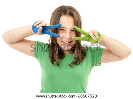 girl with green and blue paint on hands and victory gesture isolated on white - stock photo
