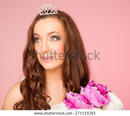 girl with hair style looking to the side. hair crown. on a pink background - stock photo