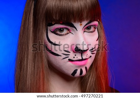 girl  with Halloween face art on grey background