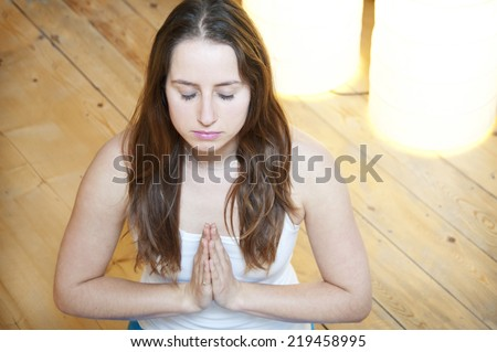 Girl with hands folded