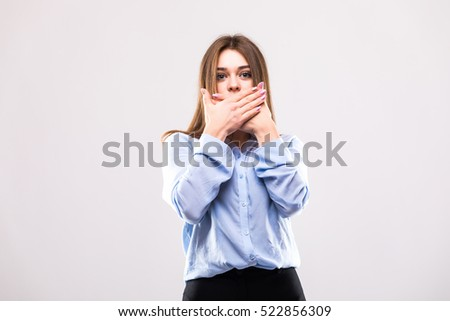 Girl with hands near mouth  on white