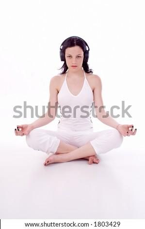 girl with head phones practice yoga - stock photo