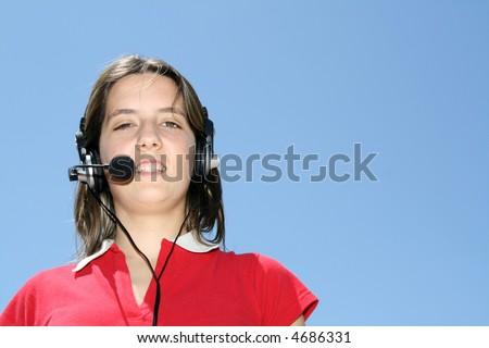 girl with headphones (call center) in blue background