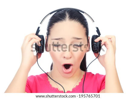 Girl With Headphones Listening Music on White Background