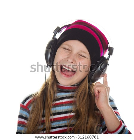 Girl with headphones listening to music on a white background. - stock photo