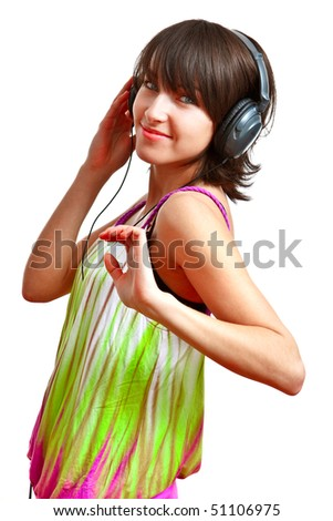 girl with headphones on - listening and dancing - stock photo