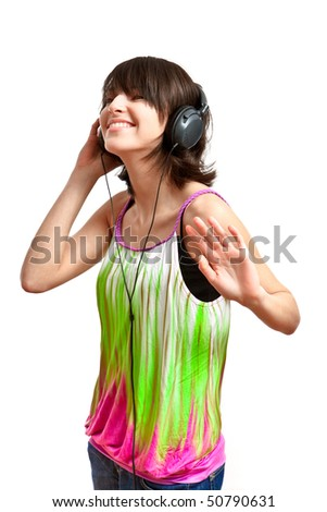 girl with headphones on - listening and dancing, on white background - stock photo