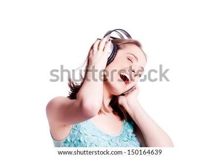 Girl With Headphones Singing and Dancing  On White Background - stock photo