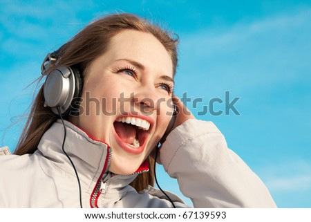 Girl with headphones winter