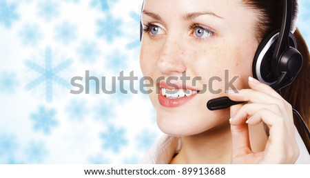 Girl with headset against winter background with snowflakes