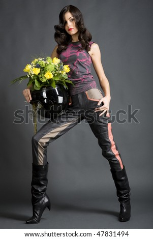 Girl with helmet and flowers - stock photo