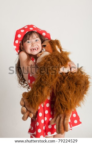 Girl with her favorite toy monkey - stock photo