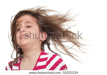 Girl with her hair blowing in the wind isolated on white - stock photo