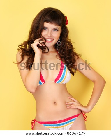 girl with her hair in a bathing suit - stock photo
