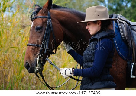Girl with her horse. - stock photo