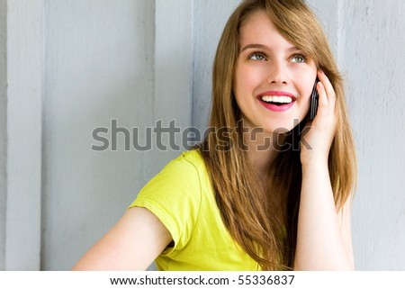 Girl with her mobile phone - stock photo