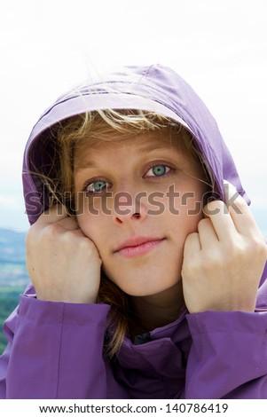 Girl with hooded jacket - stock photo