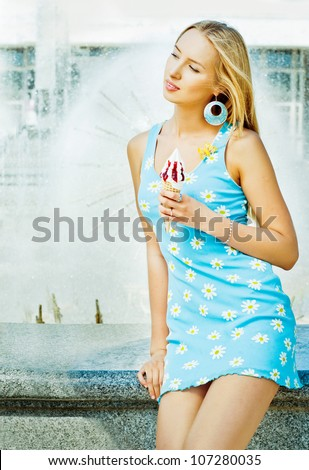 Girl with ice cream at the fountain - stock photo