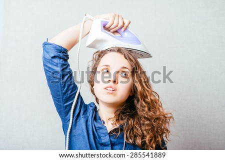 girl with iron - stock photo