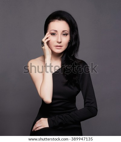 girl with jewelry.Young woman in black dress - stock photo
