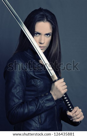 Girl with katana in studio - stock photo