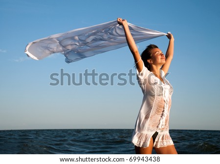 Girl with kerchief on the sunset. Relax scene - stock photo