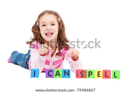 Girl with kids blocks saying I can spell. Isolated on white. - stock photo