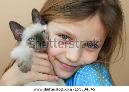 girl with kitten - stock photo
