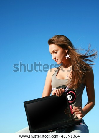 Girl with laptop and blue sky