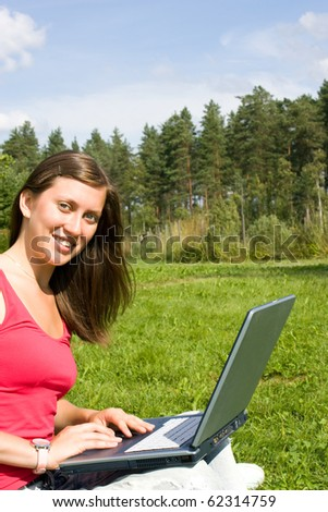Girl with laptop on the nature - stock photo