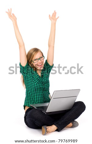 Girl with laptop raising her arms in joy - stock photo