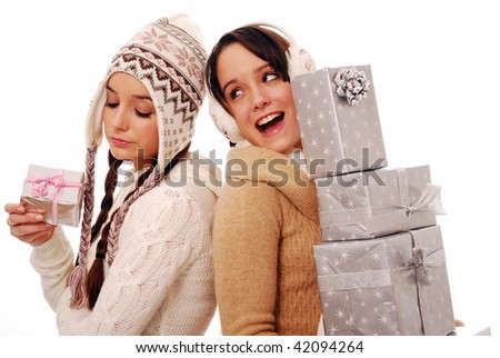 Girl with large stack of presents showing off on white background - stock photo