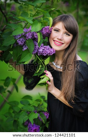 Girl with lilac in the park - stock photo