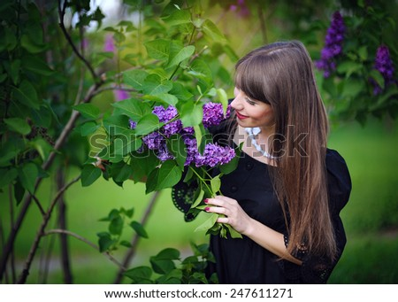 girl with lilacs in the spring in the park. - stock photo
