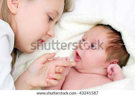 girl with little brother - stock photo