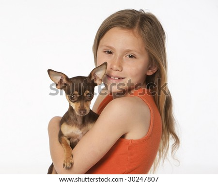Girl with little dog - stock photo